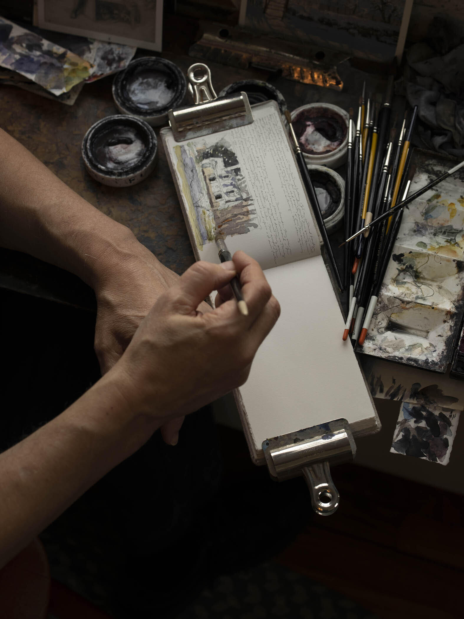 Photograph of the Artist Painting in His Journal, 2020 image