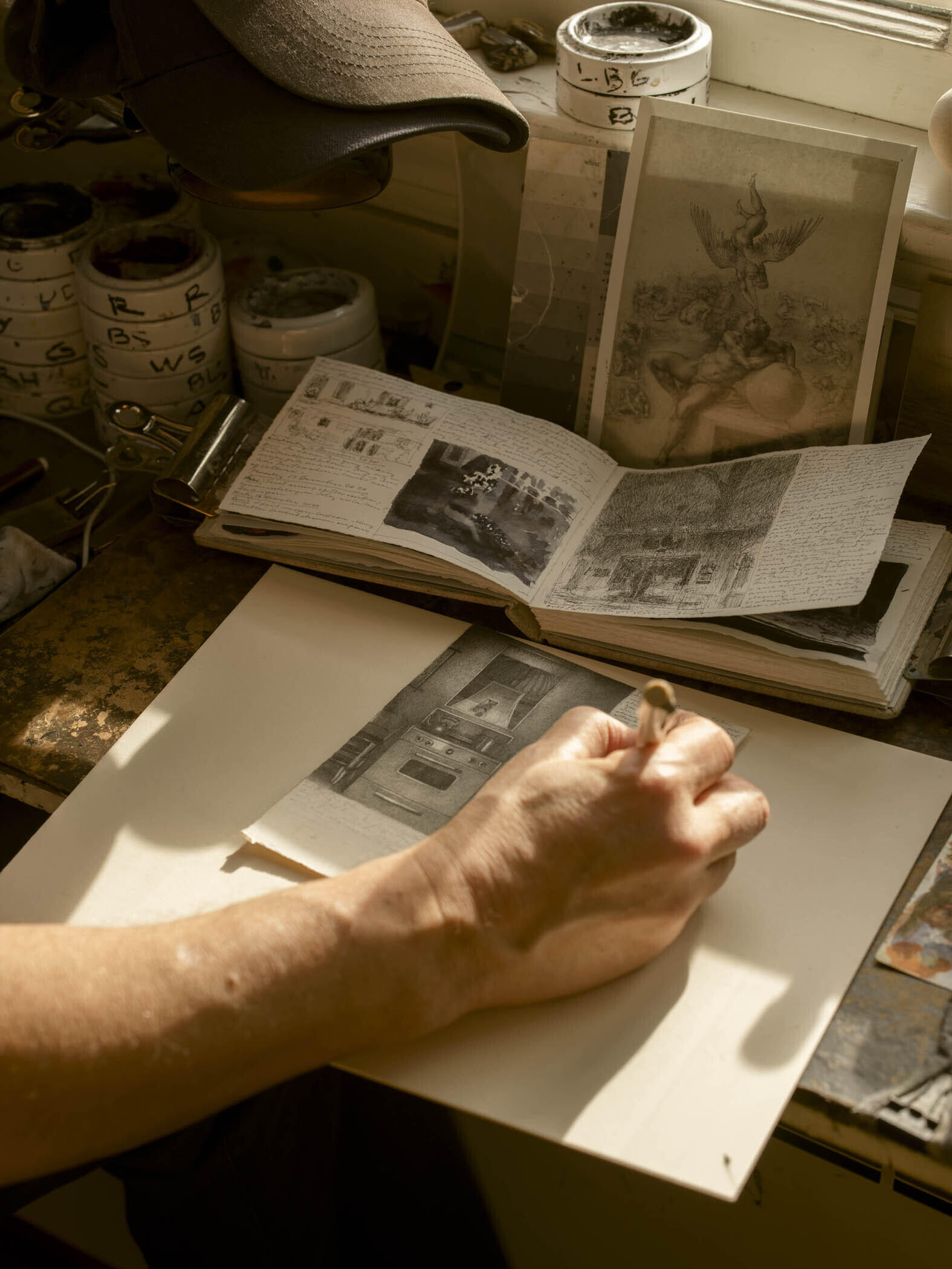 Photograph of the Artist Working on a Drawing, 2020 image