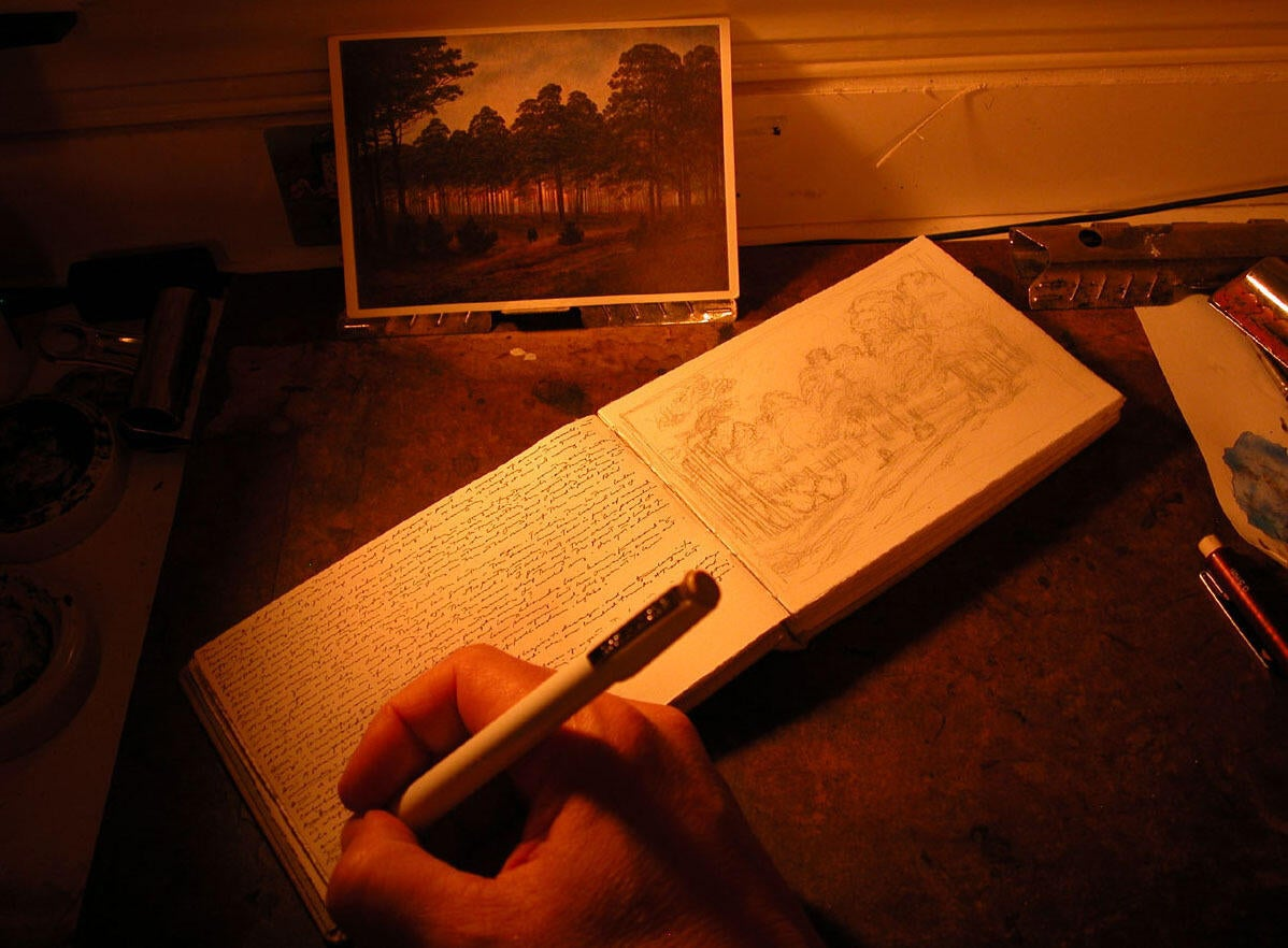 Photograph of the artist working in his journal. See biweekly Instagram updates @JasonHaam during August 2020. image