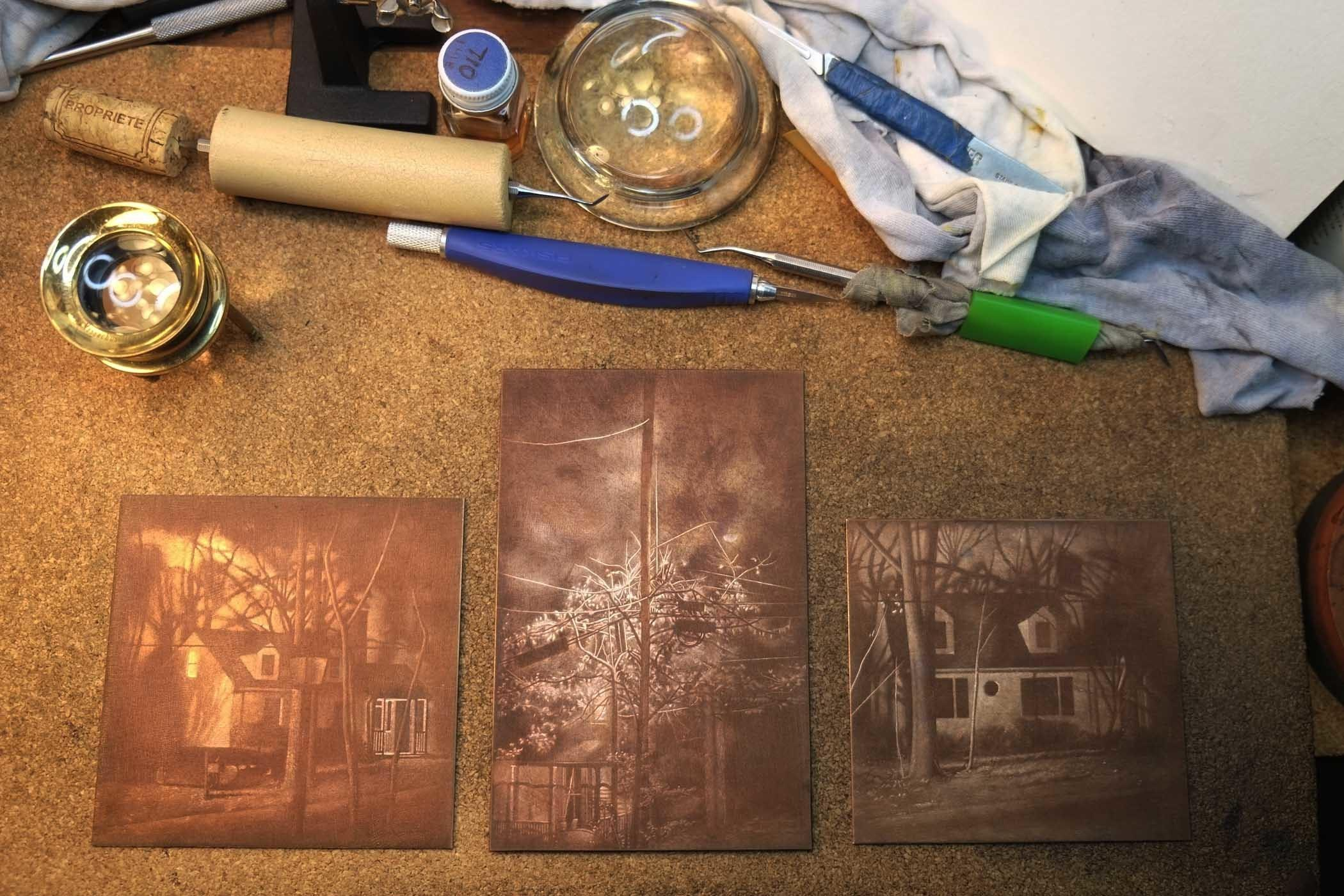 Photograph of three copper mezzotint plates, works in progress. image