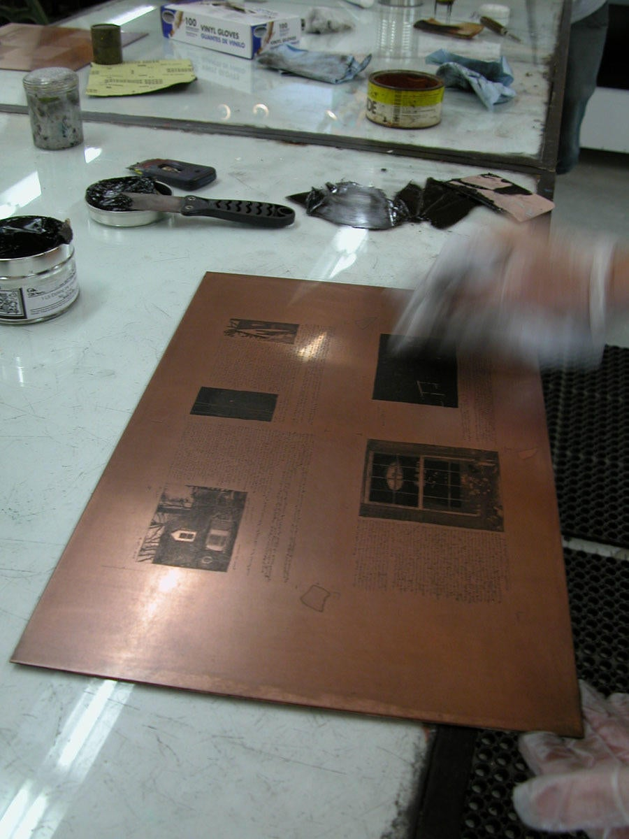 Photograph of plate being inked for printing image