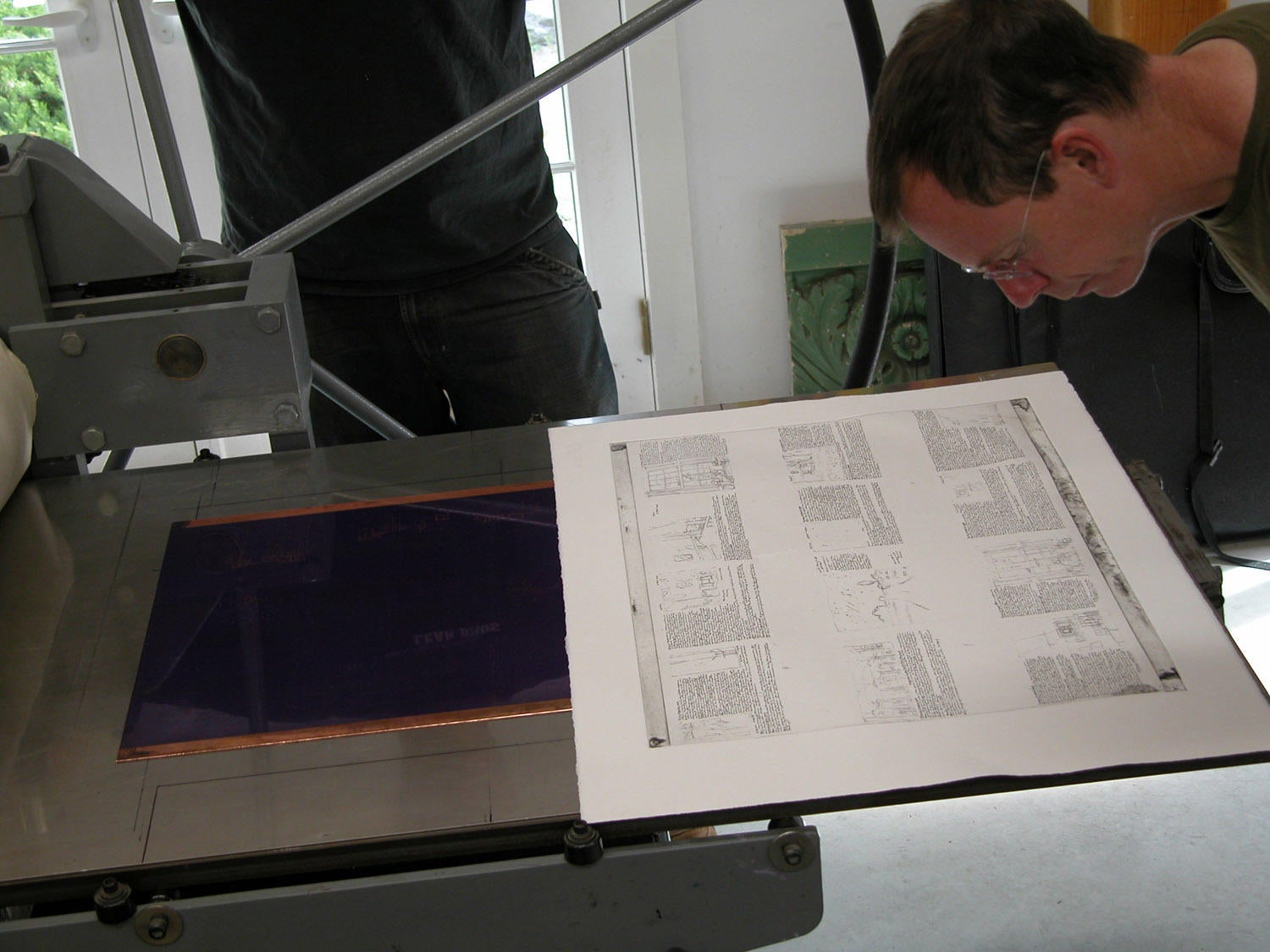 Photograph of Jim Stroud Examining Accordion Fold Print image